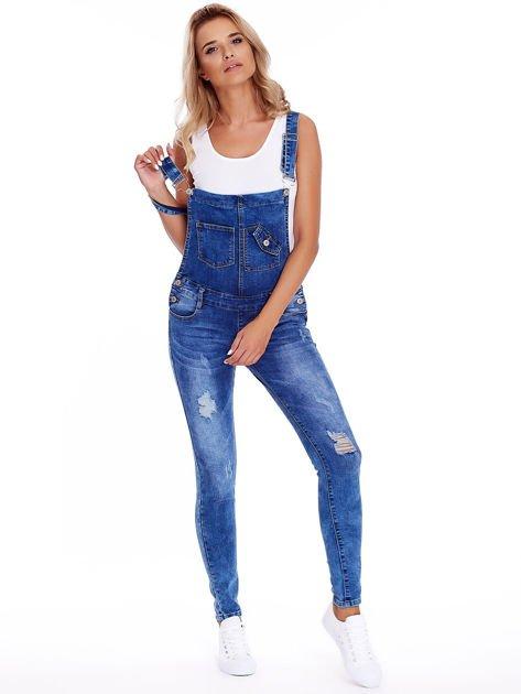 Niebieskie jeansowe ogrodniczki z przetarciami                              zdj.                              4