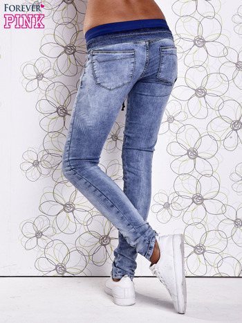 Niebieskie jeansowe spodnie na gumkę i z troczkami                                  zdj.                                  3