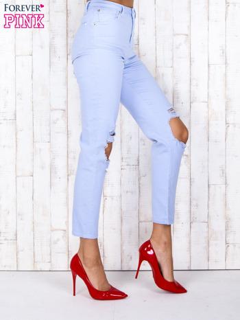 Niebieskie jeansowe spodnie z dziurami i kieszeniami                                  zdj.                                  3