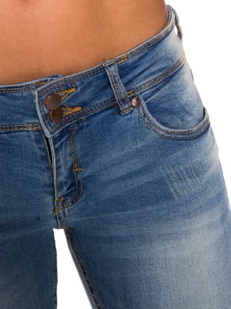 Niebieskie jeansy rurki wycierane                                  zdj.                                  5