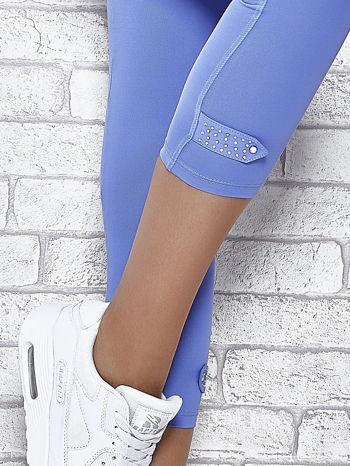 Niebieskie legginsy sportowe termalne z patką z dżetów                                  zdj.                                  6