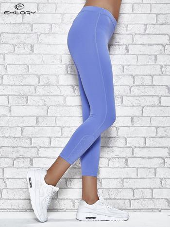 Niebieskie legginsy sportowe z dżetami na dole nogawki                                  zdj.                                  3