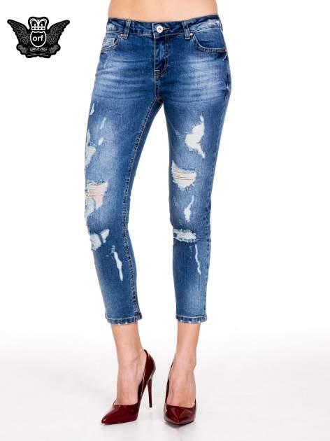 Niebieskie spodnie jeans 7/8 z dziurami i przetarciami                                  zdj.                                  1