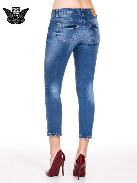 Niebieskie spodnie jeans 7/8 z dziurami i przetarciami                                  zdj.                                  2