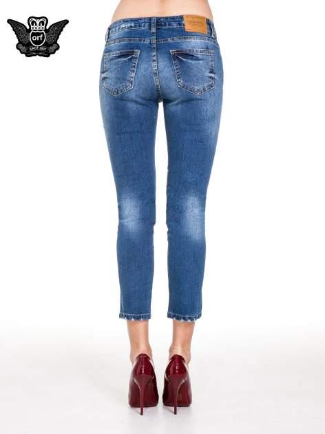 Niebieskie spodnie jeans 7/8 z dziurami i przetarciami                                  zdj.                                  5