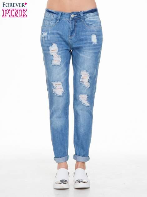 Niebieskie spodnie jeansowe boyfriendy z przetarciami                                  zdj.                                  1