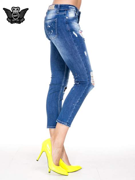 Niebieskie spodnie jeansowe długości 7/8 z łatami i przetarciami                              zdj.                              3