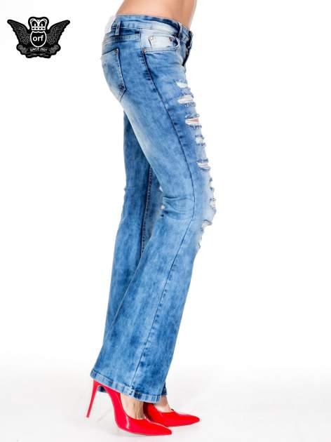 Niebieskie spodnie jeansowe dzwony z rozdarciami cut out                                  zdj.                                  3