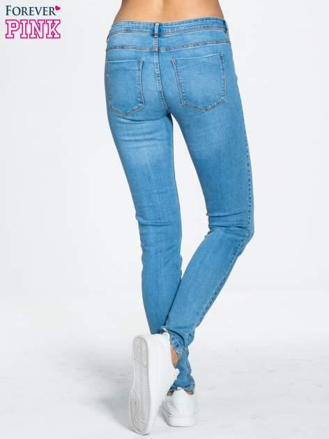Niebieskie spodnie jeansowe super skinny                                  zdj.                                  4