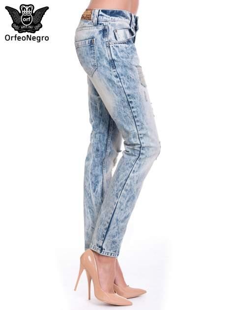 Niebieskie spodnie jeansowe z wytarciami                                  zdj.                                  3