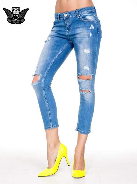 Niebieskie spodnie skinny jeans 7/8 z dziurami i przetarciami