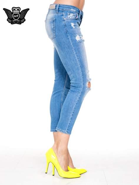 Niebieskie spodnie skinny jeans 7/8 z dziurami i przetarciami                                  zdj.                                  3