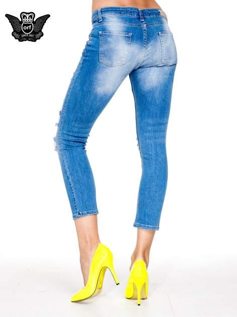 Niebieskie spodnie skinny jeans 7/8 z dziurami i przetarciami                                  zdj.                                  4