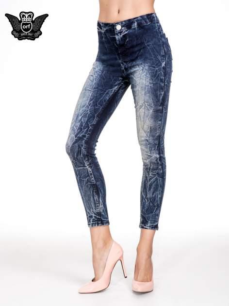Niebieskie spodnie skinny jeans z efektem destroyed