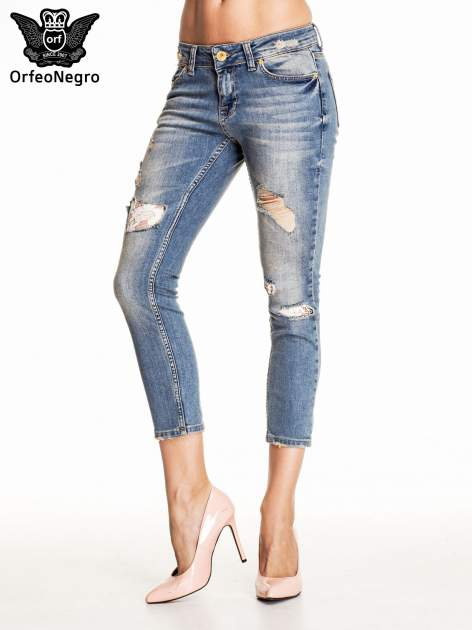 Niebieskie spodnie skinny jeans z koronkowymi łatami