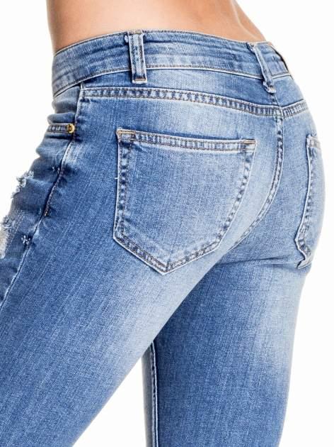 Niebieskie spodnie skinny jeans z łatami                                  zdj.                                  6