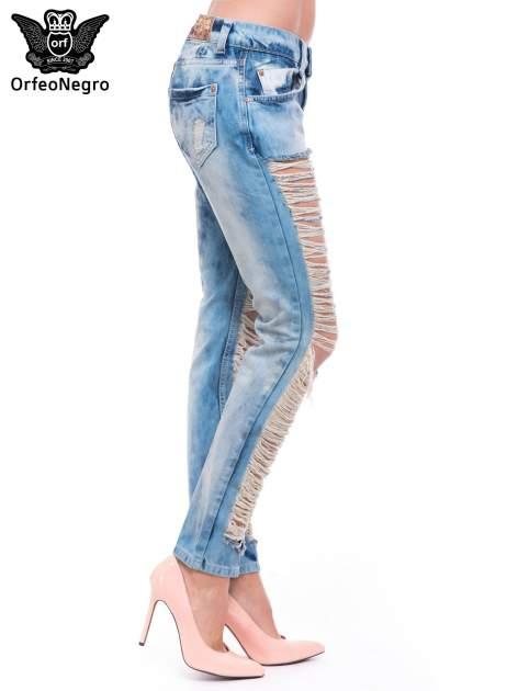 Niebieskie spodnie trash jeans z cieniowaniem                                  zdj.                                  3
