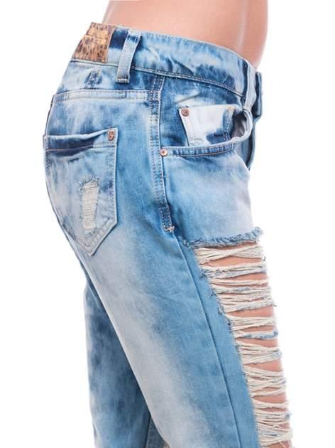Niebieskie spodnie trash jeans z cieniowaniem                                  zdj.                                  7
