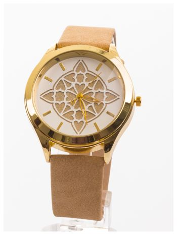 Ozdobny damski zegarek. Tarcza ozdobiona ładnym motywem.