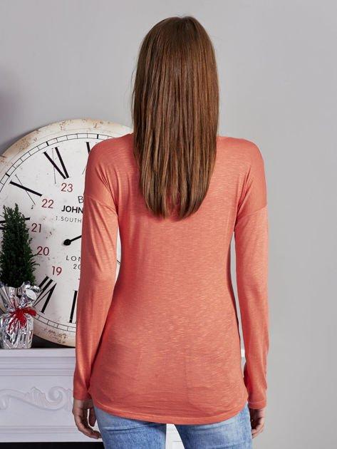 Pomarańczowa bluzka z nadrukiem cekinowych gwiazd                              zdj.                              2
