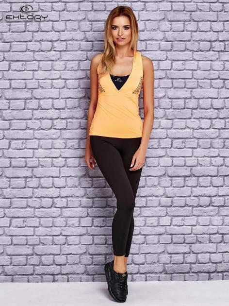 Pomarańczowy top sportowy z krzyżowanymi ramiączkami na plecach                                  zdj.                                  2