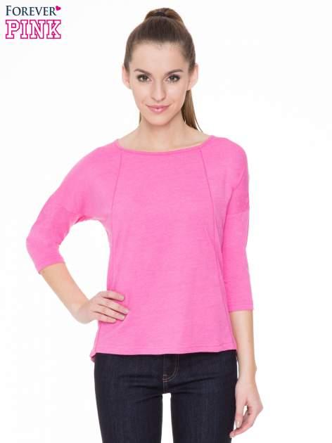Różowa gładka bluzka z ozdobnymi przeszyciami                                  zdj.                                  1
