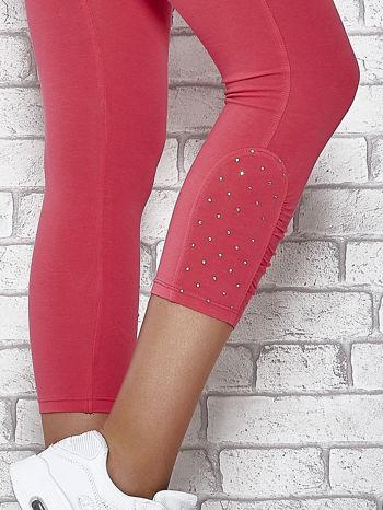 Różowe legginsy sportowe z aplikacją z dżetów na nogawkach                                  zdj.                                  6