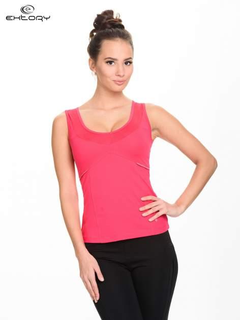 Różowy damski top sportowy z wycięciem na plecach
