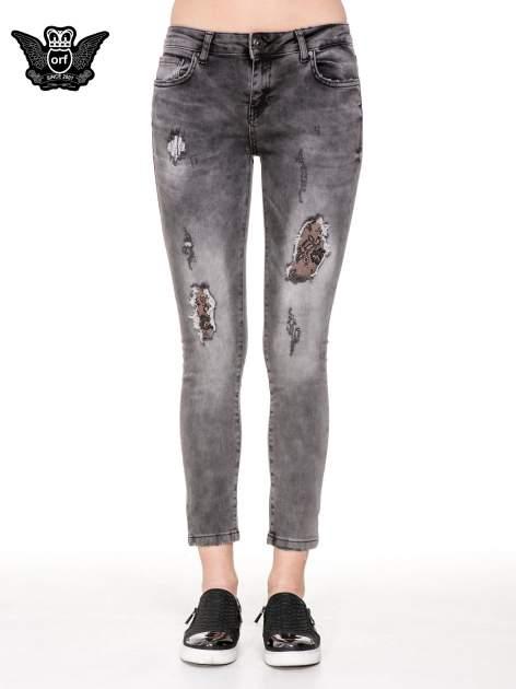 Szare spodnie skinny jeans z dziurami podszytymi koronką                                  zdj.                                  5