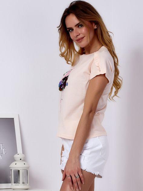 T-shirt brzoskwiniowy z cekinowym flamingiem                              zdj.                              3