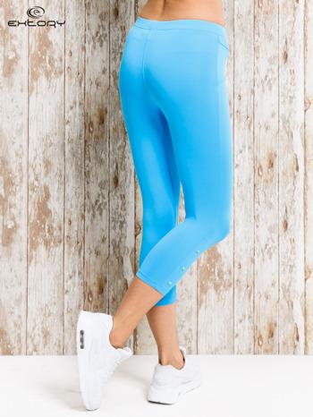 Turkusowe legginsy sportowe z nitami