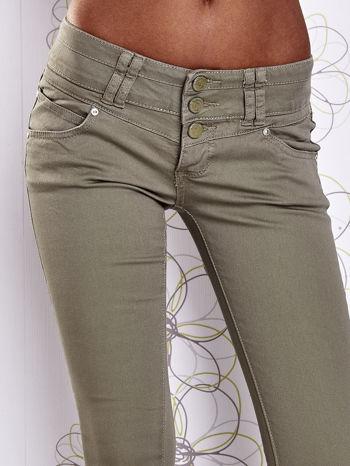 Zielone strechowe spodnie skinny z kieszeniami                                  zdj.                                  4