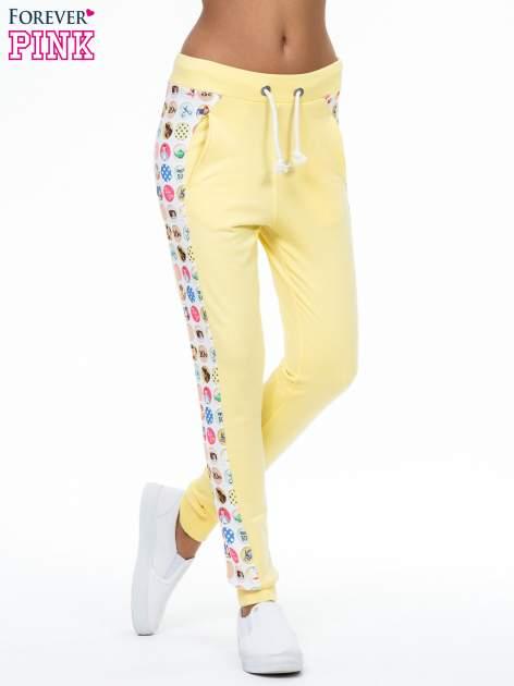 Żółte spodnie dresowe z kolorowym lampasem