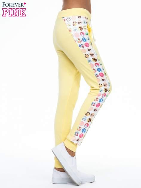 Żółte spodnie dresowe z kolorowym lampasem                                  zdj.                                  3