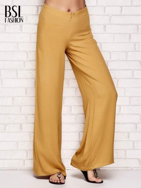 Żółte zwiewne spodnie typu palazzo                                  zdj.                                  1