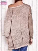 Beżowa dekatyzowana bluzka oversize z łapaczem snów
