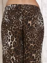 Ciemnobrązowe lejące spodnie w panterkę