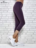 Ciemnofioletowe legginsy sportowe z dżetami na dole nogawki                                  zdj.                                  2
