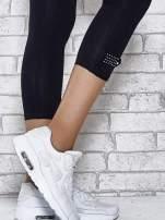Ciemnogranatowe legginsy sportowe z patką z dżetów na dole                                  zdj.                                  6