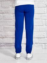 Ciemnoniebieskie spodnie dresowe dla dziewczynki LITTLE UNICORN                                  zdj.                                  2