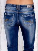 Ciemnoniebieskie spodnie dzwony jeansowe z przetarciami                                  zdj.                                  5