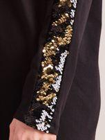Czarna bluzka z wiązaniem i cekinami                                  zdj.                                  7