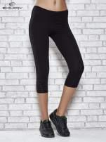 Czarne legginsy sportowe z dżetami i marszczoną nogawką za kolano                                  zdj.                                  1