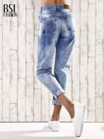 Jasnoniebieskie spodnie boyfriend jeans z dziurami                                  zdj.                                  3