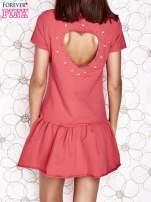 Jasnoróżowa dresowa sukienka z wycięciem na plecach