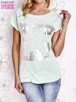 Miętowy t-shirt z motywem gwiazdy i dżetami                                  zdj.                                  1