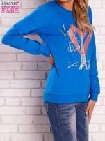 Niebieska bluza z motywem paryskim
