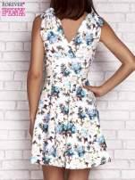 Niebieska rozkloszowana sukienka w kwiaty                                  zdj.                                  2