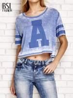 Niebieski t-shirt acid wash z literą A                                                                          zdj.                                                                         1