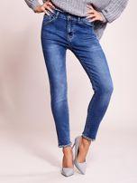 Niebieskie jeansowe spodnie z aplikacją                                  zdj.                                  1